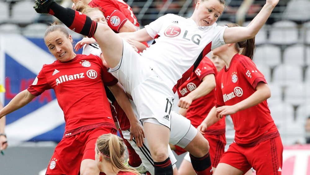 MUNICH, GERMANY - MAY 01: Marina Hegering of Bayer Leverkusen is thrown off balance as she competes for a corner kick during the Women's Bundesliga match at Gruenwalder Street Stadium on May 01, 2016 in Munich, Bavaria. (Photo by Adam Pretty/Bongarts/Getty Images)