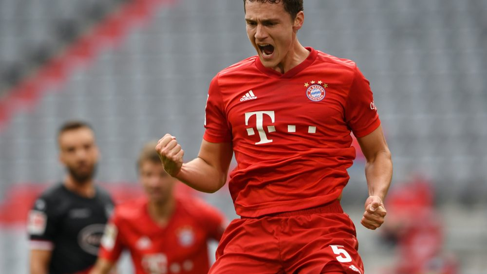 MUNICH, GERMANY - MAY 30: Benjamin Pavard of Bayern Munich celebrates after scoring his team's second goal during the Bundesliga match between FC Bayern Muenchen and Fortuna Duesseldorf at Allianz Arena on May 30, 2020 in Munich, Germany. (Photo by Christof Stache/Pool via Getty Images)